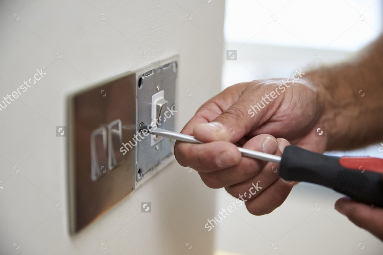 stock-photo-close-up-of-electrician-repairing-domestic ...